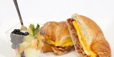 Ham and cheese croissant with fruit cup
