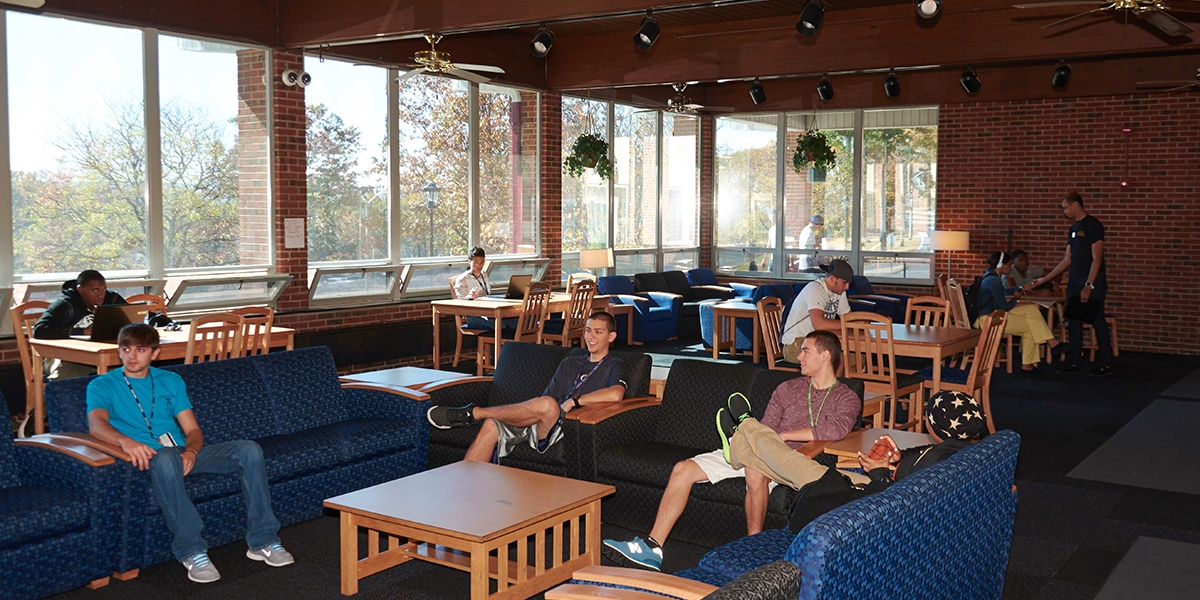 A group of students visits in the lounge of North Hall at Penn State Hazleton.