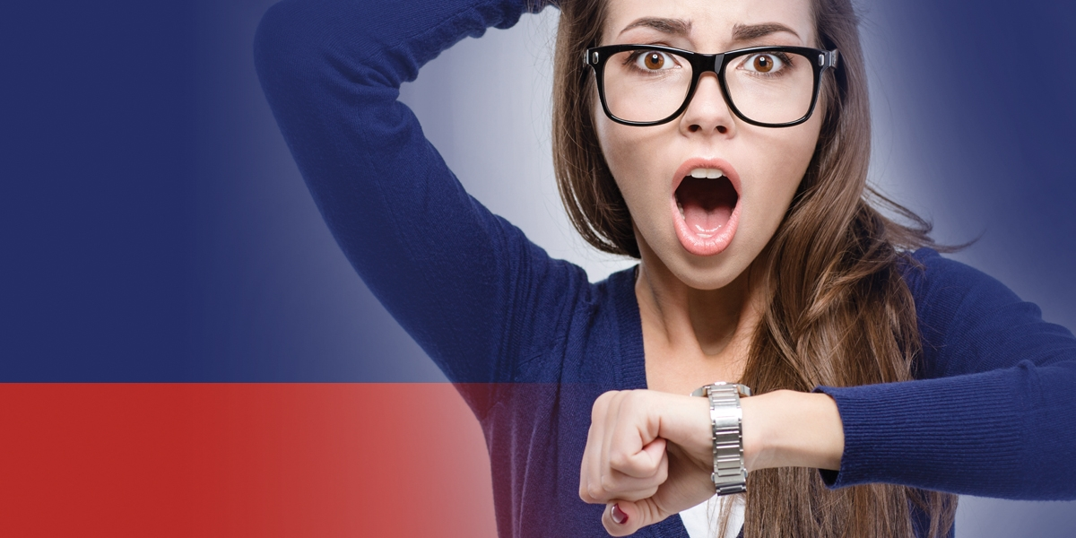 Woman looking at watch in horror